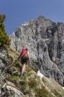 Hiker during ascent to Lampskopf — Stock Photo