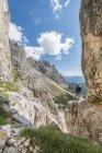 Hiker at Rosengarten group mountains, Dolomites, South Tyrol, Trentino-Alto Adige, Italy, Europe — Stock Photo