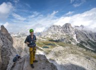 Hiker at Rosengarten group massif in Dolomites, South Tyrol, Italy — Stock Photo