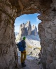 Hiker at via ferrata at Paternkofel, view war tunnel in South Tyrol, Alto-Adige, Italy, Europe — Stock Photo