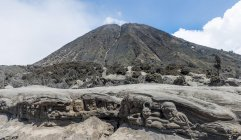 Faces carved into rock at Mount Batok, Bromo Tengger Semeru National Park, Java, Indonesia, Asia — Stock Photo