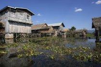 Rural scene of traditional stilt houses in village on Inle Lake, Shan State, Myanmar, Asia — Stock Photo