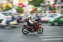 Scooter driver in heavy traffic with motion blur, Ho Chi Minh City, Vietnam, Asia — Stock Photo