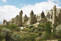 Fairy chimneys tufa rock formations in Love Valley of Goreme National Park, Turkey — Stock Photo