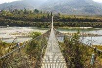 Suspension Brücke von Bhutan über Fluss Puna Tsang Chhu, Punakha, Bhutan, Asien — Stockfoto