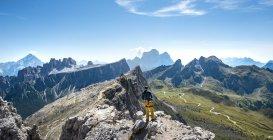 Hiker on summit of Averau, Dolomites, South Tyrol, Trentino-Alto Adige, Italy, Europe — Stock Photo