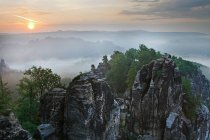 Sunrise with fog over Saxon Switzerland National Park, Saxony, Germany, Europe — Stock Photo