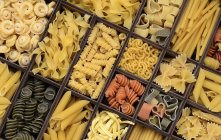 Various types of pasta in type case — Stock Photo