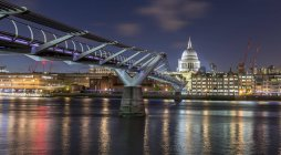 Millennium Bridge and Saint Paul Cathedral by night, London, England, Great Britain — Stock Photo
