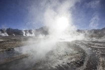 Rising steam over El Tatio geyser in San Pedro de Atacama, Antofagasta Region, Chile, South America — Stock Photo