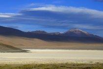Clouds over mountains near Laguna Ramaditas, Nor Lipez province, Potosi department, Bolivia, South America — Stock Photo