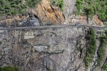 Truck riding on narrow Yungas mountain road between La Paz and Coroico, Bolivia, South America — стоковое фото