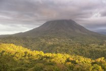 Volcano in clouds in Arenal Volcano National Park, Alajuela Province, Costa Rica, Central America — Stock Photo