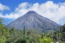 Volcano and clouds in Arenal Volcano National Park, Alajuela Province, Costa Rica, Central America — Stock Photo