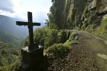 Roadside cross at Yungas mountain road between La Paz and Coroico, Bolivia, South America — стокове фото