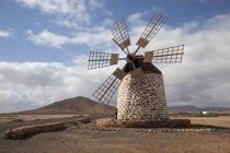 Windmill in barren landscape of Molino de Tefia, Tefia, Fuerteventura, Canary Islands, Spain, Europe — Stock Photo