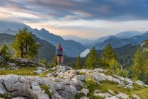 Young woman looking at mountain panorama over Knigssee from Feldkogel, National Park Berchtesgaden, Upper Bavaria, Bavaria, Germany, Europe — Stock Photo