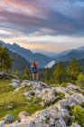 Female hiker in mountains over Knigssee in National Park Berchtesgaden, Upper Bavaria, Bavaria, Germany, Europe — Stock Photo