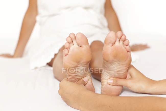 Woman's feet being massaged — Stock Photo