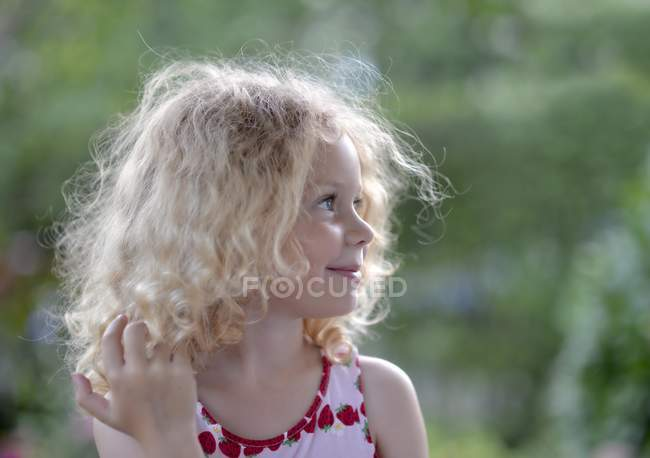 Girl with blonde curly hair — Stock Photo