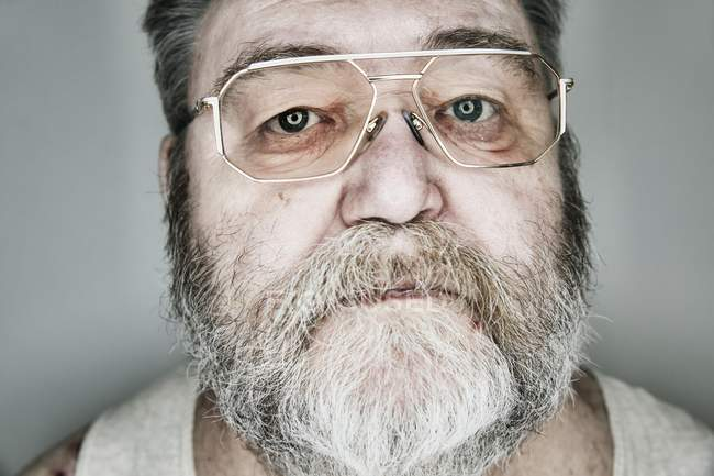 Senior with beard and glasses — Stock Photo