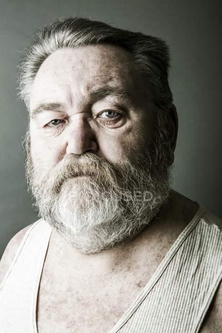 Obese senior with full beard — Stock Photo