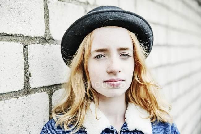 Portrait of teenage girl in hat — Stock Photo