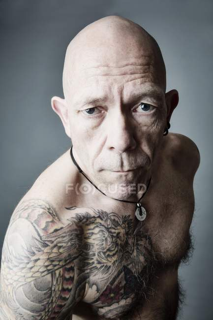 Tattooed man with bald head — Stock Photo