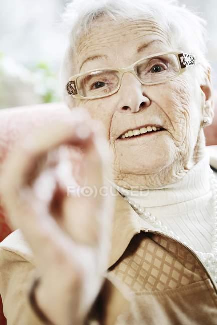 Portrait of senior woman gesturing — Stock Photo