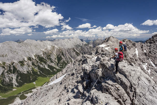 Hikers on summit ridge during the ascent in Austrian Alps, Tyrol, Austria — Stock Photo