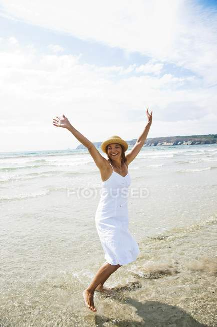 Cheerful woman on beach — Stock Photo