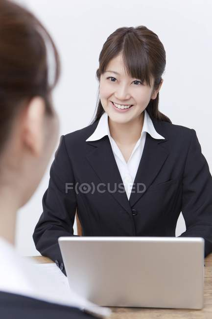 Asian businesswoman smiling while meeting — Stock Photo