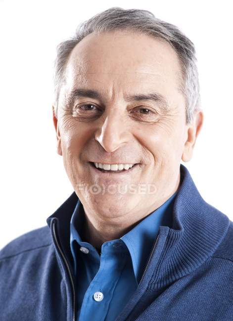 Elderly man looking at camera — Stock Photo
