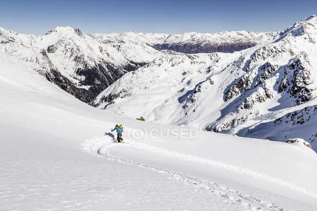 Ski tourer ascending Hintere Nonnenspitze — стоковое фото