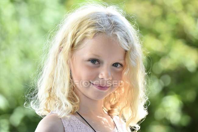 Blonde girl looking at camera — Stock Photo