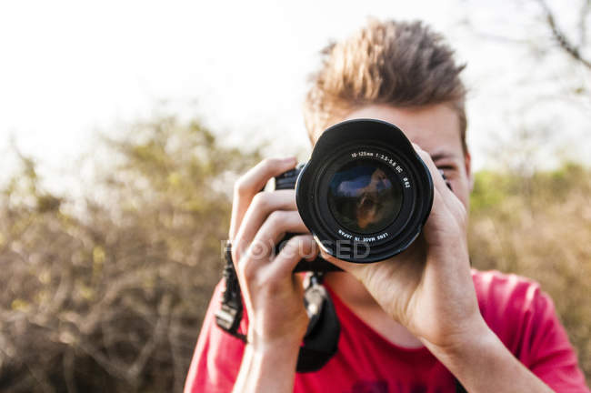 Portrait of man taking a picture with digital camera — Stock Photo