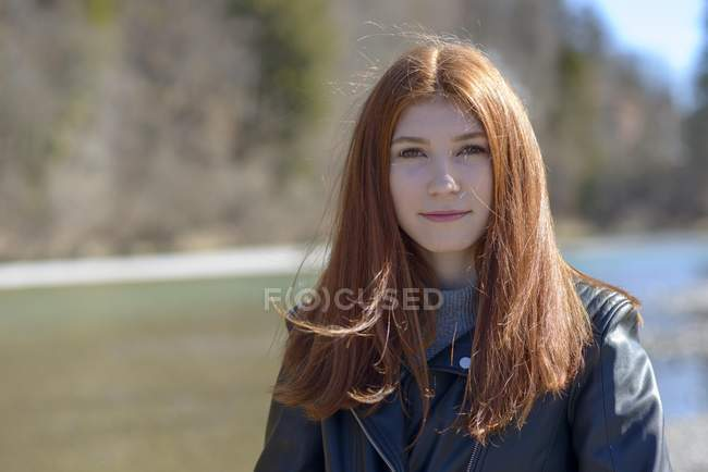 Portrait of teenage girl with long red hair. — Stock Photo