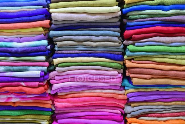 Stacked colorful woven fabric materials — Stock Photo