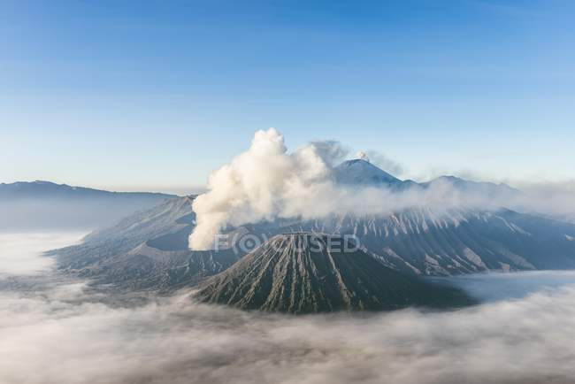 Smoking volcano Gunung Bromo in Bromo Tengger Semeru National Park, Java, Indonesia, Asia — стокове фото