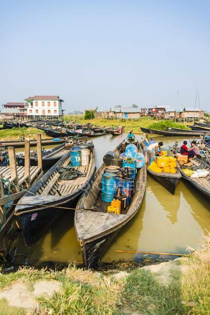 Wooden boats with oil barrels in harbor of Nampan, Inle Lake, Shan State, Myanmar, Asia. — Stock Photo