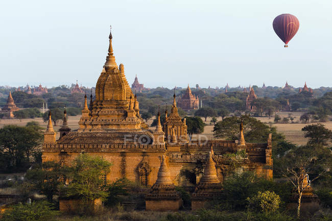 Aerial view of balloon riding over temple site at sunset, Bagan, Myanmar, Asia — Stock Photo