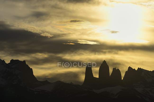Torres del Paine mountains at sunset with clouds in Chile, South America — Stock Photo