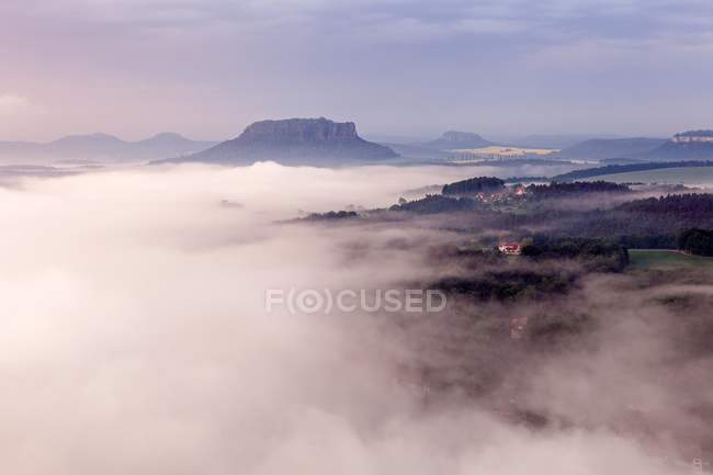 High angle view of Saxon Switzerland National Park in morning mist, Saxony, Germany, Europe — стоковое фото