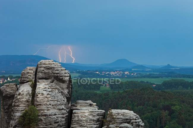 Thunderstorm over village in Saxon Switzerland National Park, Saxony, Germany, Europe — Stock Photo