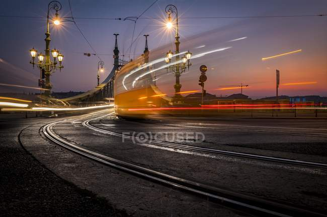 Liberty bridge with driving tram at blue hour, Budapest, Hungary, Europe — Stock Photo