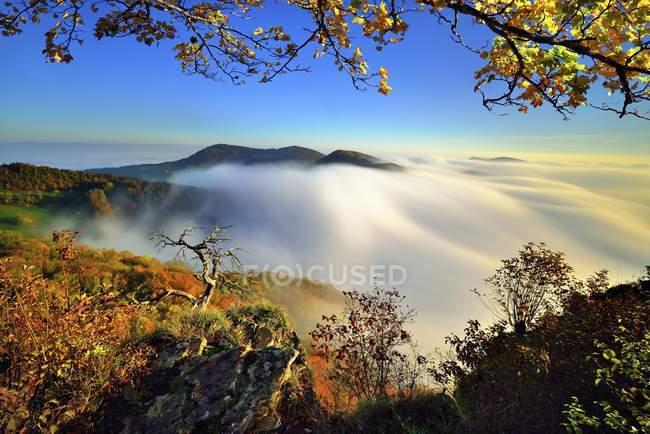 Sunrise on Wasserflue mountain with foggy landscape in autumn, Jura Park, Canton of Aargau, Switzerland, Europe — Stock Photo