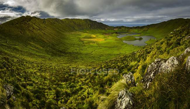 Crater of Caldeirao Volcano with green vegetation, Corvo Island, Azores, Portugal, Europe — стоковое фото