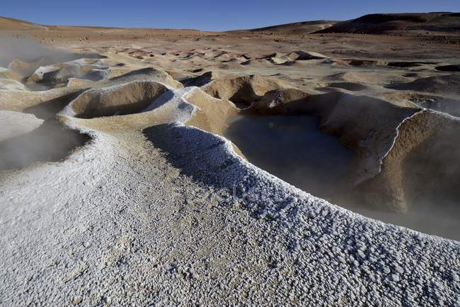 Geysers with water vapor frozen at Sol de Manana geothermal field, Altiplano, Bolivia, South America — Photo de stock