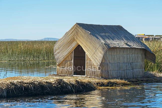 Reed Hut On Floating Island Of Uros On Lake Titicaca Puno Peru