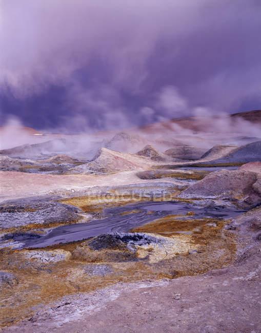 Geyser and sulphurous smoke clouds, Sol de Manana, Altiplano, Bolivia, South America — Stock Photo